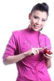 De Aziatische appel van het vrouwenomhulsel Stock Foto's