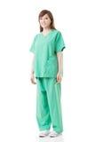 De Aziatische artsenvrouw draagt een isolatietoga of verrichtingstoga Stock Foto's