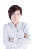 De Aziatische bedrijfsvrouw kruist haar wapen met slechte stemming Royalty-vrije Stock Afbeelding