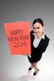De Aziatische bedrijfsvrouw zegt gelukkig nieuw jaar 2016 Royalty-vrije Stock Afbeeldingen