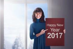 De Aziatische bedrijfsvrouw zegt gelukkig nieuw jaar 2017 Stock Foto's