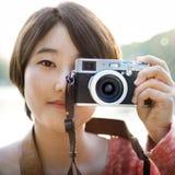 De Aziatische Beelden van Meisjestakin door Cameraconcept Stock Foto's
