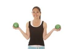 De Aziatische groene ballen van de vrouwenoefening Stock Afbeelding