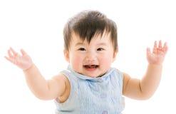 De Aziatische hand van het babymeisje omhoog stock afbeeldingen