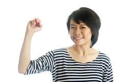 De Aziatische jonge tekening van de vrouwenhand Royalty-vrije Stock Afbeelding