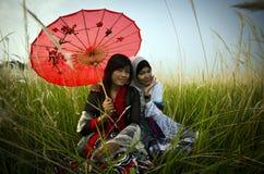 De Aziatische meisjes stock afbeeldingen