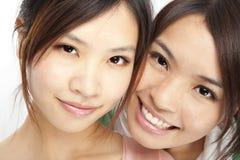 De Aziatische meisjes zien onder ogen Stock Foto