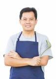 De Aziatische Mens kruist Zijn Wapen met het Koken van Hulpmiddel Stock Afbeeldingen