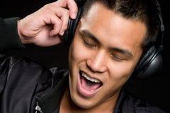 De Aziatische Mens van de Muziek royalty-vrije stock afbeelding