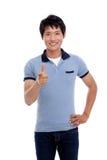 De Aziatische mens wijst op iets. Stock Foto