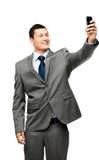 De Aziatische mobiele telefoon van het zakenman videooverseinen Royalty-vrije Stock Afbeeldingen