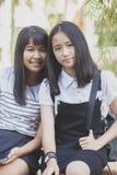 De Aziatische tiener twee het glimlachen tijd van de de emotievakantie van het gezichtsgeluk royalty-vrije stock foto