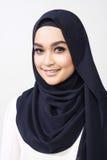 De Aziatische uitdrukking van de muslimahvrouw stock foto's