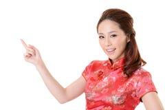 De Aziatische vrouw introduceert Stock Afbeeldingen