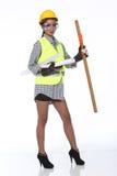 De Aziatische vrouw van ArchitectenEngineer in gele bouwvakker, enorme veiligheid royalty-vrije stock foto