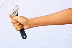 De greep van de hand de regelbare moersleutel Royalty-vrije Stock Fotografie