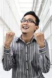 De Aziatische zakenman van de succeswinnaar stock foto
