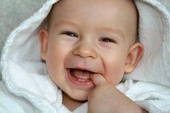 De baby in een peignoir Royalty-vrije Stock Afbeeldingen