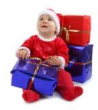 De baby en de giften van Kerstmis stock foto