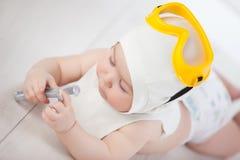 De baby kiest een beroep stock afbeeldingen
