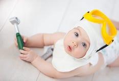 De baby kiest een beroep stock afbeelding