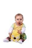 De baby kijkt verrast omdat het spaarvarken leeg is Royalty-vrije Stock Fotografie