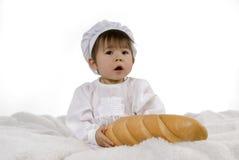 De baby van de chef-kok met brood Royalty-vrije Stock Afbeelding