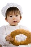 De baby van de chef-kok met brood Stock Afbeeldingen