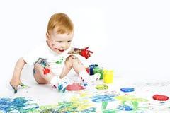 De baby van de schoonheid met verf op wit Royalty-vrije Stock Foto