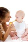 De baby van het moedervoer Stock Foto