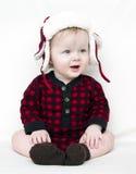De baby van Kerstmis met rode overhemd en hoed Stock Foto's