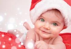 De Baby van Kerstmis van de kerstman met Magische Fonkelingen Royalty-vrije Stock Foto