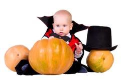 De babyjongen van Halloween met het pumpking van 3 Stock Foto's
