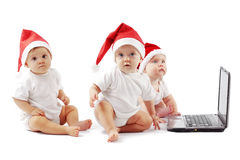 De babys van Kerstmis met laptop Stock Foto's