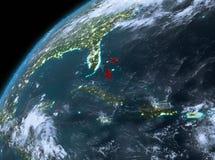 De Bahamas op aarde in ruimte bij nacht Stock Afbeeldingen