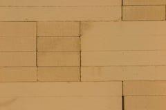 De baksteen en het blok voor bouwachtergrond Stock Foto
