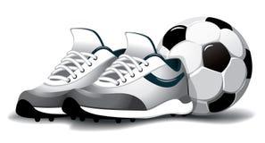 De bal en de laarzen van het voetbal Stock Afbeelding