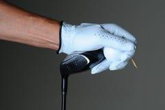 De Bal van de Club van de Hand van de Golfspeler van de close-up Stock Afbeeldingen