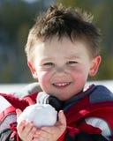 De bal van de jongen en van de sneeuw Stock Fotografie