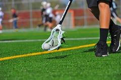 De bal van de lacrosse in een hoofd stock afbeeldingen
