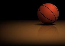 De bal van het basketbal op de vloer Royalty-vrije Stock Fotografie