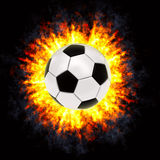 De bal van het voetbal in krachtige explosie Stock Afbeelding