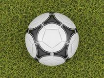 De bal van het voetbal op een achtergrond van het grasgebied Stock Afbeelding