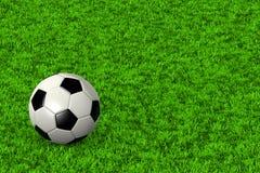 De bal van het voetbal op grasgebied Royalty-vrije Stock Fotografie