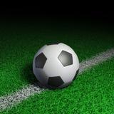 De bal van het voetbal op groen gras Vector Illustratie