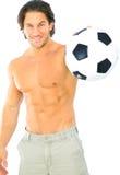 De Bal van het Voetbal van de Holding van de Mens van de geschiktheid Stock Foto