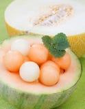 De ballen van de meloen met munt stock fotografie