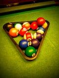 De ballen van de pool op lichtstraal royalty-vrije stock foto's