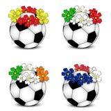 De ballen van het voetbal met bloemen nationale vlaggen royalty-vrije stock foto's