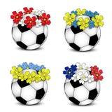 De ballen van het voetbal met bloemen nationale vlaggen stock afbeelding